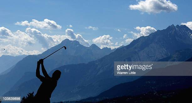 Miguel Angel Jimenez of Spain plays his second shot into the 14th green during the third round of The Omega European Masters at Crans-Sur-Sierre Golf...