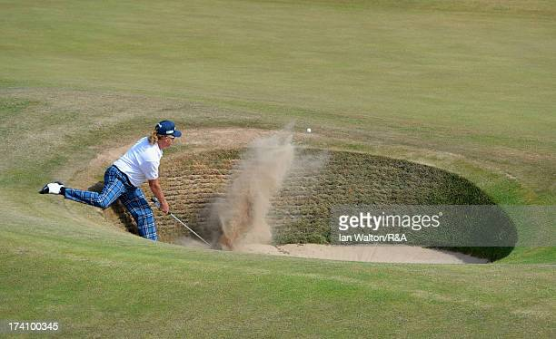 Miguel Angel Jimenez of Spain plays out of a bunker on the fourth hole during the third round of the 142nd Open Championship at Muirfield on July 20...