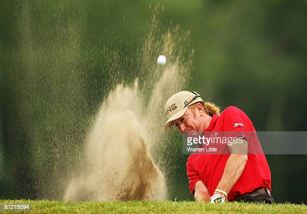 Miguel Angel Jimenez of Spain plays out of the 13th bunker on the 15th hole during Day 2 of the BMW PGA Championship at Wentworth on May 23 2008 in...