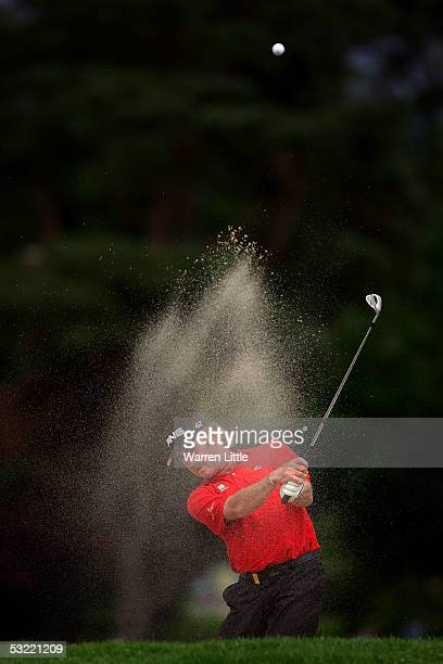 Miguel Angel Jimenez of Spain plays out of the bunker on the ninth hole during the final round of The Barclays Scottish Open at Loch Lomond on July...