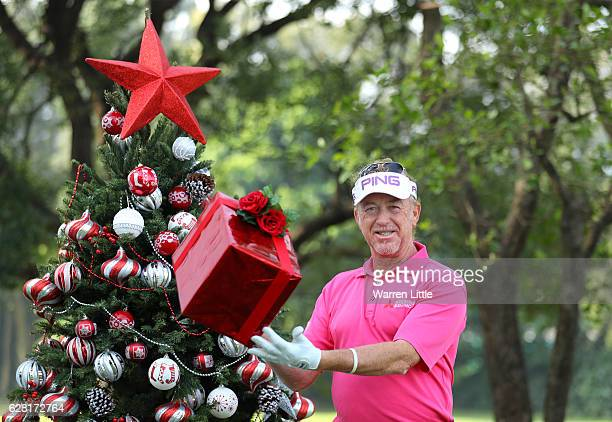 Miguel Angel Jimenez of Spain poses with a Christmas tree during the pro-am ahead of the UBS Hong Kong Open at The Hong Kong Golf Club on December 7,...