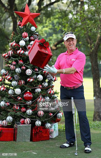 Miguel Angel Jimenez of Spain poses with a present by a Christmas tree during the pro-am ahead of the UBS Hong Kong Open at The Hong Kong Golf Club...