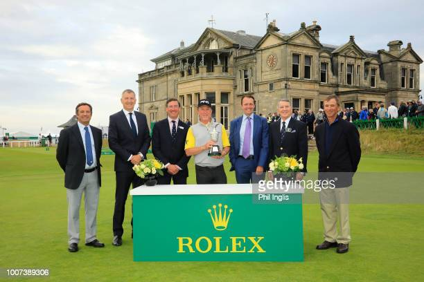 Miguel Angel Jimenez of Spain poses with officials at the prize presentation including David Williams, Tournament Director, Senior Open Championship,...