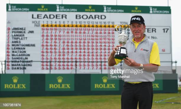 Miguel Angel Jimenez of Spain poses with the Senior Open Trophy after winning the Senior Open Presented by Rolex during the Final Round on Day Four...
