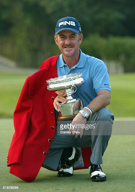 Miguel Angel Jimenez of Spain poses with the Trophy after he won it by 14 under par 266 during the Final Round of the Omega Hong Kong Open held at...