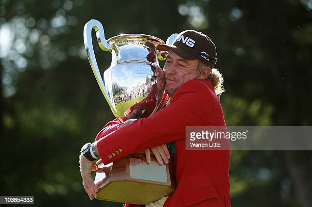 Miguel Angel Jimenez of Spain poses with the trophy after winning The Omega European Masters on a score of 21 under par at CransSurSierre Golf Club...