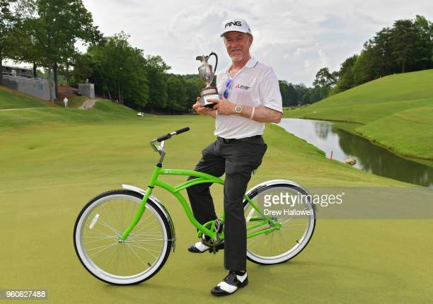 Miguel Angel Jimenez of Spain poses with the trophy and winners green bike after the Regions Tradition at Greystone Golf Country Club on May 20 2018...