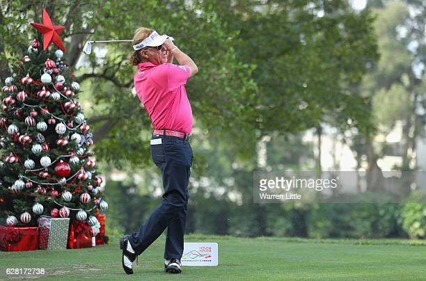 Miguel Angel Jimenez of Spain tees off next to a Christmas tree during the pro-am ahead of the UBS Hong Kong Open at The Hong Kong Golf Club on...