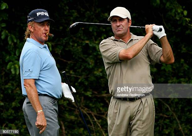 Miguel Angel Jimenez of Spain walks up as Jose Maria Olazabal watches a shot during the third day of practice prior to the start of the 2008 Masters...