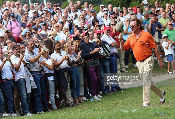 Miguel Angel Jimenez of Spain waves to the crowd as they welcome him onto the first tee during the second round of the 72nd Open d'Italia at Golf...