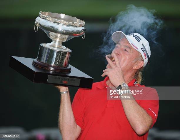 Miguel Angel Jimenez of Spain with the winners trophy and his cigar after the final round of the UBS Hong Kong open at The Hong Kong Golf Club on...