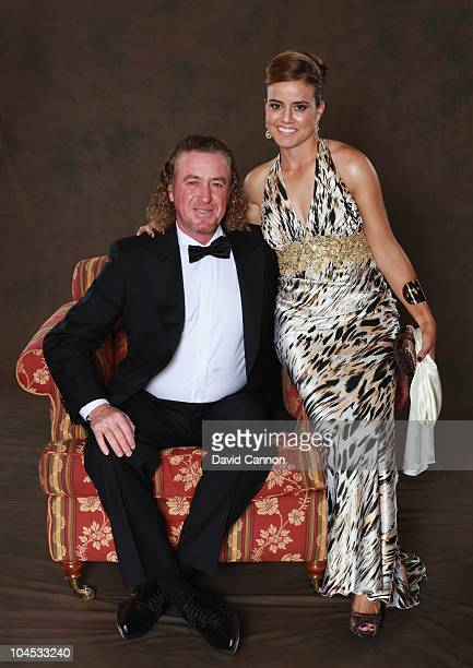 Miguel Angel Jimenez of the European Ryder Cup poses with partner Marian Jimenez prior to the 2010 Ryder Cup Dinner at the Celtic Manor Resort on...
