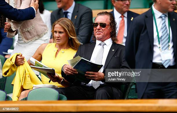 Miguel Angel Jimenez Rodriguez and wife Susanna Styblo on Centre Court for the Ladies' Singles Fourth Round match between Serena Williams of the...