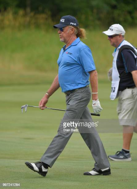 Miguel Angel Jiménez walks along the second hole during the first round of the PGA TOUR Champions Constellation SENIOR PLAYERS Championship at Exmoor...