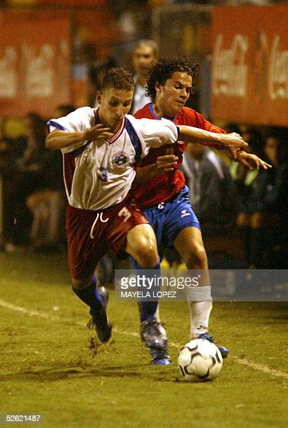 Miguel Angel Lopez from Cuba views for the ball with Roberto Carrillo from Costa Rica 12 April 2005 at the Eladio Rosabal Cordero Stadium in Heredia...