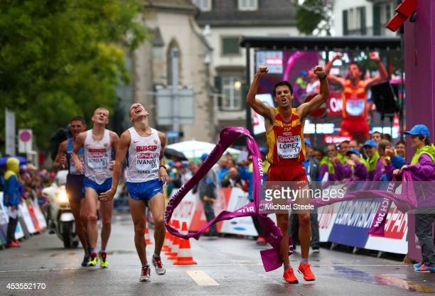 Miguel Angel Lopez of Spain cross the line to win gold ahead of Aleksandr Ivanov of Russia and Denis Strelkov of Russia in the Men's 20km Walk final...