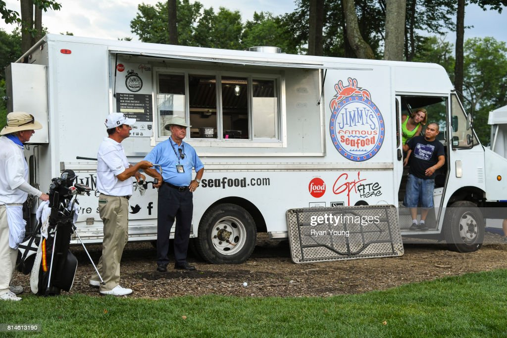 Miguel Angel Martin consults rules official Gene Smith after his ball came to rest near a food truck on the 17th hole during the second round of the PGA TOUR Champions Constellation SENIOR PLAYERS Championship at Caves Valley Golf Club on July 14, 2017 in Baltimore, Maryland.