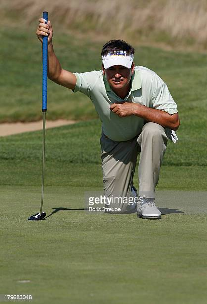 Miguel Angel Martin of Spain lines up a putt during the first round on day one of the WINSTONgolf Senior Open played at WINSTONgolf on September 6...