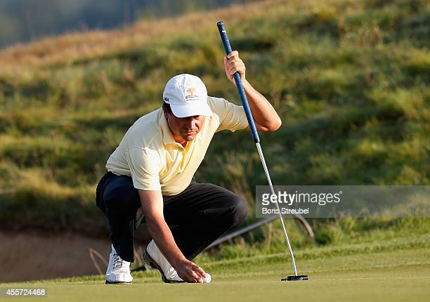 Miguel Angel Martin of Spain lines up a putt during the first round on day one of the WINSTONgolf Senior Open played at WINSTONgolf on September 19...