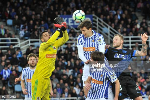 Miguel Angel Moya Jon Bautista and Diego Llorente of Real Sociedad during the Spanish league football match between Real Sociedad and Alaves at the...