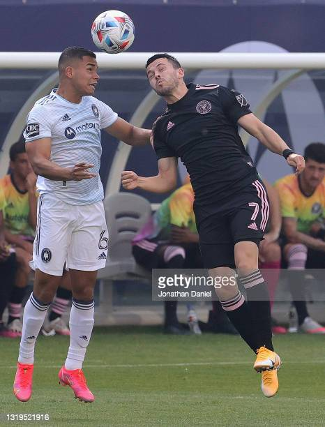 Miguel Angel Navarro of Chicago Fire heads the ball away from Lewis Morgan of Inter Miami at Soldier Field on May 22, 2021 in Chicago, Illinois.