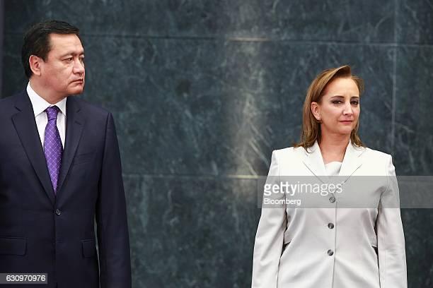 Miguel Angel Osorio Chong Mexico's secretary of the interior left and Claudia Ruiz Massieu Salinas Mexico's former minister of foreign affairs stand...