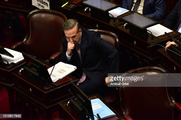 Miguel Angel Pichetto Senator for Rio Negro gestures while senators vote for the new abortion law on August 8 2018 in Buenos Aires Argentina The bill...