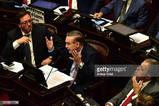 Miguel Angel Pichetto Senator for Rio Negro reacts while senators vote for the new abortion law on August 8 2018 in Buenos Aires Argentina The bill...