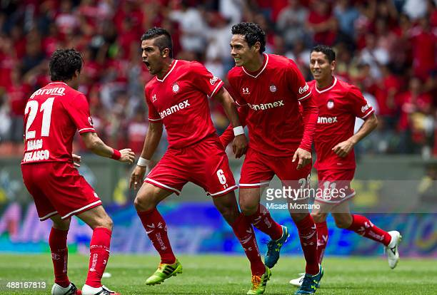 Miguel Angel Ponce of Toluca celebrates with his teammates after scoring the second goal against Xolos de Tijuana during the Quarterfinal second leg...