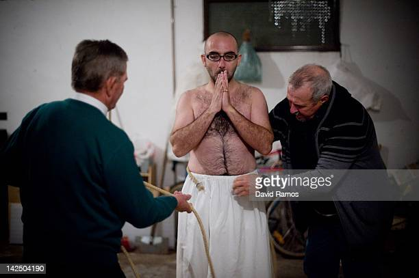 Miguel Angel Portillo aged 33 is dressed up as 'Empalao' by relatives prior to the procession of the 'Empalaos' on April 6 2012 in Valverde de la...