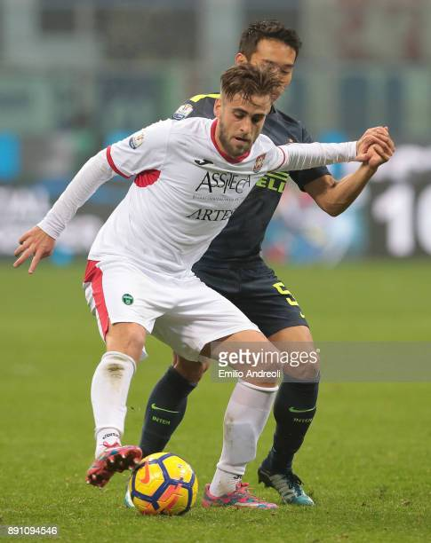 Miguel Angel SainzMaza of Pordenone Calcio competes for the ball with Yuto Nagatomo of FC Internazionale Milano during the TIM Cup match between FC...
