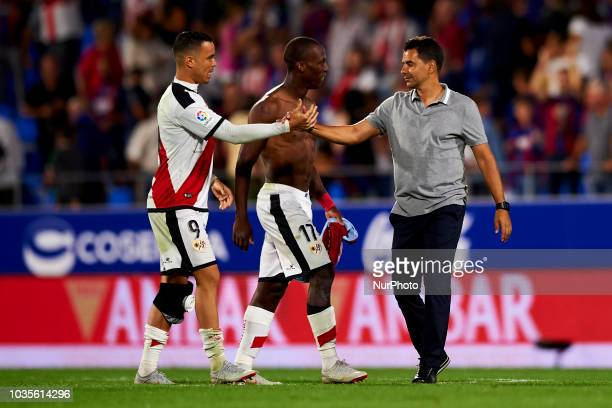 Miguel Angel Sanchez coach of Rayo celebrates victory whit his players Raul de Tomas and Luis Advincula after the match between SD Huesca against...