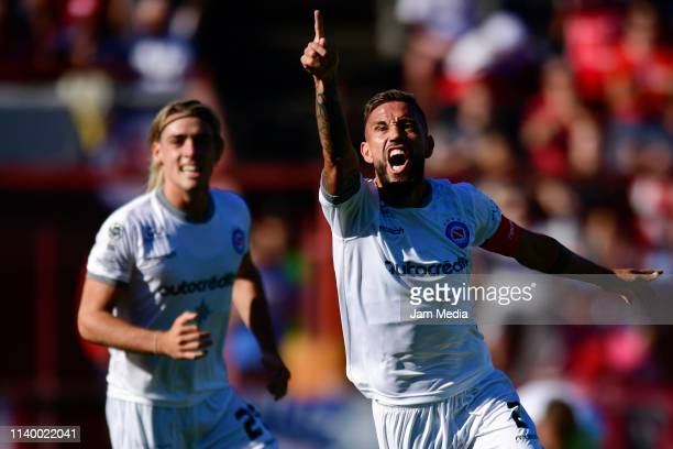 Miguel Angel Torren of Argentinos Juniors celebrates after scoring his side's first goal during a round of sixteen first leg match between Argentinos...