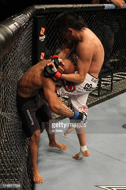 Miguel Angel Torres knees Demetrious Johnson during their bantamweight fight at UFC 130 at the MGM Grand Garden Arena on May 28, 2011 in Las Vegas,...