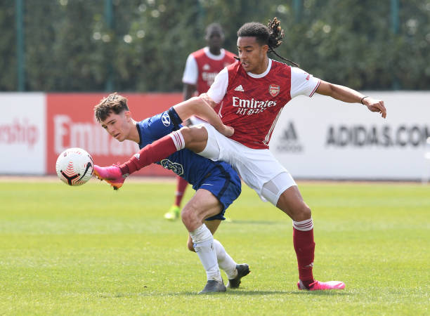 Miguel Azeez of Arsenal challenges Joe Haigh of Chelsea during the U18 Premier League south match between Arsenal u18 and Chelsea U18 at London...