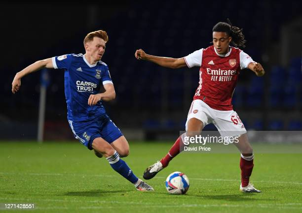 Miguel Azeez of Arsenal takes on Jon Nolan of Ipswich during the Leasingcom Cup match between Ipswich Town and Arsenal U21 at Portman Road on...