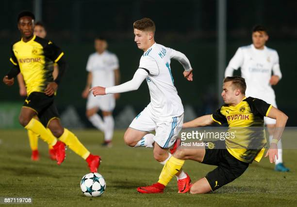 Miguel Baeza of Real Madrid duels for the ball during the UEFA Youth Champions League group H match between Real Madrid and Borussia Dortmund at...