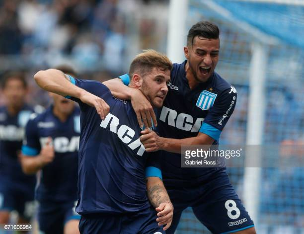 Miguel Barbieri of Racing Club celebrates with Diego Gonzalez after scoring the second goal of his team during a match between Racing and Atletico de...