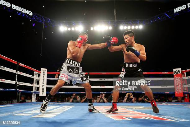 Miguel Berchelt and Takashi Miura throw punches in the first round of the WBC Super Featherweight Title Fight at The Forum on July 15 2017 in...