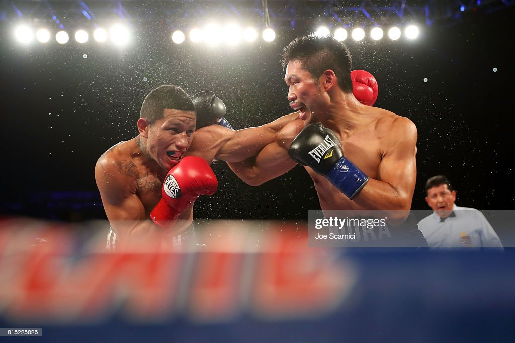 Miguel Berchelt and Takashi Miura throw punches int he sixth round of the WBC Super Featherweight Title Fight at The Forum on July 15, 2017 in Inglewood, California.
