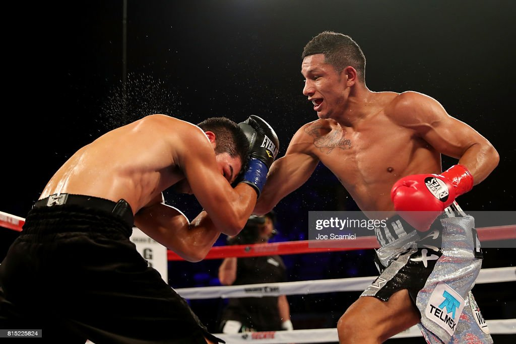 Miguel Berchelt punches Takashi Miura in the third round of the WBC Super Featherweight Title Fight at The Forum on July 15, 2017 in Inglewood, California.
