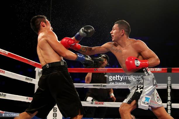Miguel Berchelt punches Takashi Miura in the third round of the WBC Super Featherweight Title Fight at The Forum on July 15 2017 in Inglewood...