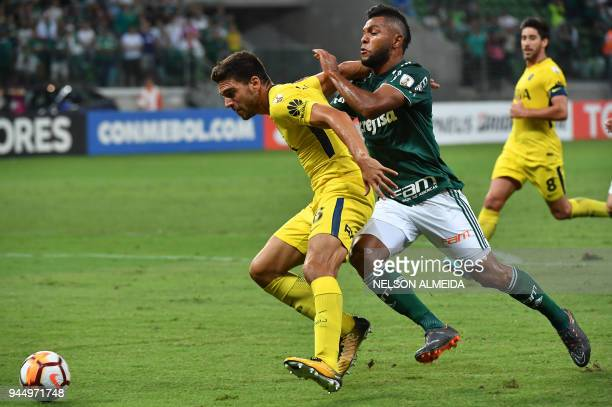 Miguel Borja of Brazil's Palmeiras vies for the ball with Lisandro Magallan of Argentina's Boca Juniors during their 2018 Copa Libertadores football...