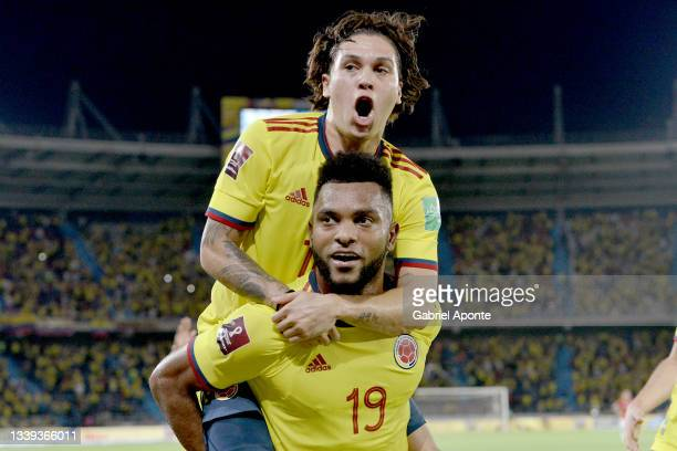 Miguel Borja of Colombia celebrates with teammate Juan Quintero after scoring the second goal of their team during a match between Colombia and Chile...
