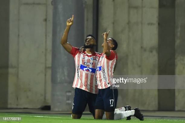 Miguel Borja of Junior celebrates with teammate Gabriel Fuentes after scoring the first goal of his team during a match between Junior and River...