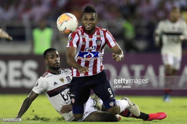 Miguel Borja of Junior fights for the ball with Gerson of Flamengo during a group A match of Copa CONMEBOL Libertadores between Junior and Flamengo...