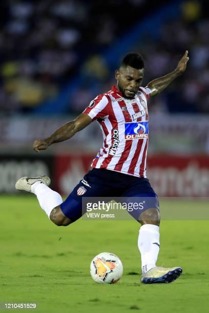 Miguel Borja of Junior kicks the ball during a group A match of Copa CONMEBOL Libertadores between Junior and Flamengo at Estadio Metropolitano on...