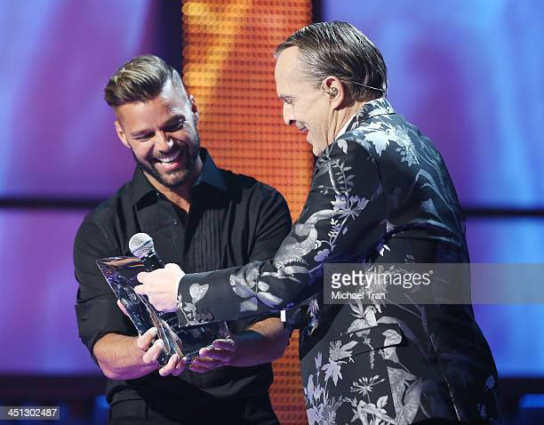 Miguel Bose accepts the Person of the Year award from Ricky Martin onstage during the 14th Annual Latin GRAMMY Awards held at Mandalay Bay Resort and...