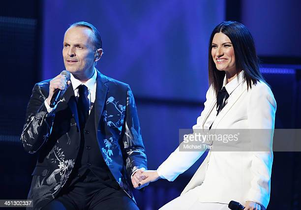 Miguel Bose and Laura Pausini perform onstage during the 14th Annual Latin GRAMMY Awards held at Mandalay Bay Resort and Casino on November 21 2013...
