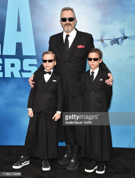 Miguel Bose and sons attend the premiere of Warner Bros Pictures and Legendary Pictures' Godzilla King of the Monsters at TCL Chinese Theatre on May...